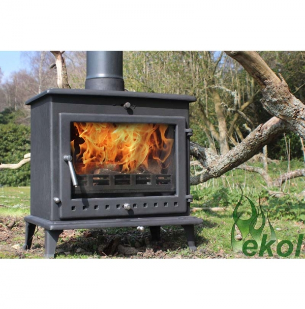 Ekol Crystal 12 woodburning stove by a tree